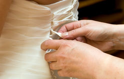 Bride dress help Stock Photography