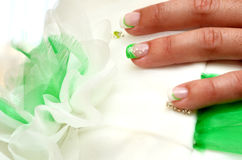 Bride dress and nails. Detail of a bride weeding dress and she´s nails Royalty Free Stock Photo