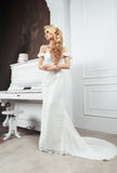 The bride in a dress with a train. Stock Images