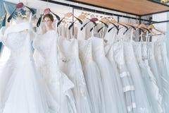 Free Bride Dress,  White Wedding Dresses In Dress Store Stock Photos - 215075823
