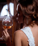 bride in dress with wine glass Royalty Free Stock Image