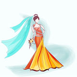Bride dressed in gown and veil holding flowers. Royalty Free Stock Photo