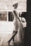 Bride dressed in a vintage style looks mysterious standing on a stock image