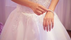 Bride dresses bracelet on the arm Royalty Free Stock Images