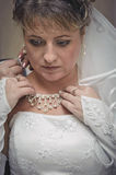 Bride dresses necklace around your neck Stock Photography