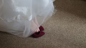 Bride dresses shoes stock footage
