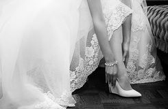 Bride dresses shoes before the wedding ceremony Royalty Free Stock Photo