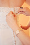 Bride dressing stock photography