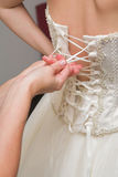 Bride dressing up Royalty Free Stock Photo
