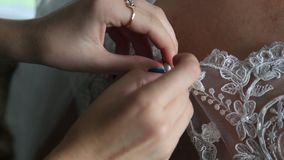 The bridegroom is dressing for wedding. stock video
