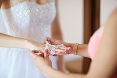 Bride dressing Stock Photo