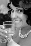 Bride with drink. Nervously smiling bride with a drink, before the ceremony Royalty Free Stock Photography