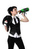 Bride drinking from a bottle of champagne Royalty Free Stock Photography