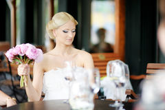 Bride drinking champagne Stock Image