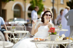 Bride drinking coffee outdoors Stock Photo