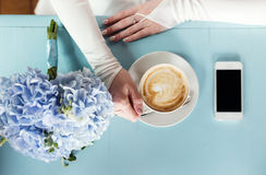 Bride drinking coffee Royalty Free Stock Photos