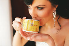 Bride drinking tea Stock Photography