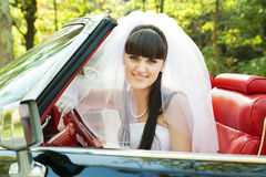 Bride driving a car Royalty Free Stock Photo