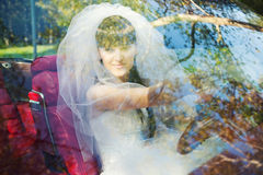 Bride driving in car Stock Images