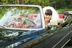 Bride driving a car Stock Photography