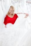 Bride is eager to try dress on Royalty Free Stock Photo