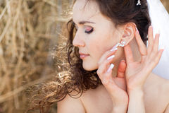 Bride with ear-ring Stock Images