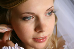Bride with earring. Portraint of a young beautiful bride wearing earring Royalty Free Stock Photos