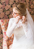 Bride and earrings Royalty Free Stock Images