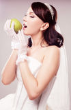 Bride eating an apple Royalty Free Stock Image