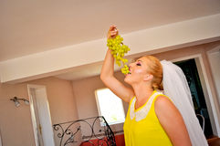 Bride eating grapes Stock Photography