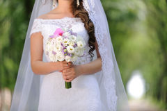 Bride and Elegant Bouquet Stock Image