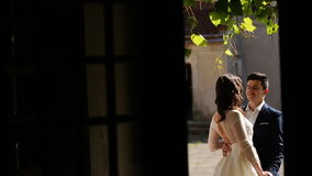 Bride embrace in the courtyard of the house.  stock footage