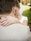 Bride embraces Groom. Bride and Groom embrace each other after their vows in a wedding Stock Image