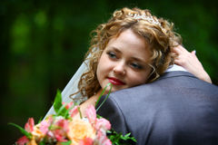Bride embracing groom Stock Photo