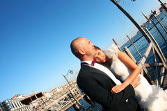 Bride embracing the groom in Venice. Sunny day stock image