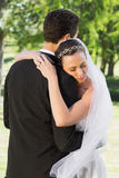 Bride embracing groom on wedding day Royalty Free Stock Photo