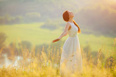 Bride Enjoying Nature. Free Happy Woman. Lit evening sun. Freedom concept Royalty Free Stock Images