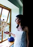 Bride enjoying a quiet moment Stock Photography