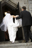 Bride entering church Royalty Free Stock Photography