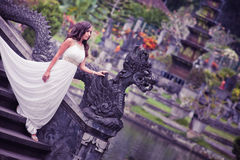 Bride in fairy park in Bali Stock Photography