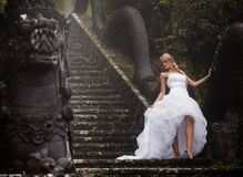 Bride in fairy park in Bali Royalty Free Stock Photography
