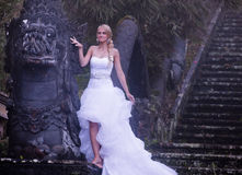 Bride in fairy park in Bali Royalty Free Stock Photos