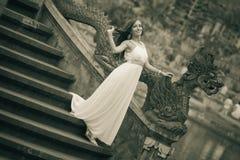 Bride in fairy park in Bali Stock Photos