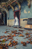 Bride in fairy tale castle in autumn Royalty Free Stock Image