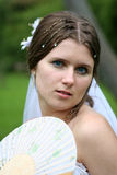 The bride with a fan Royalty Free Stock Photos
