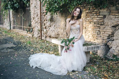 Bride fashion with romantic flower bouquet in Rome royalty free stock photos