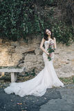 Bride fashion with romantic flower bouquet in Rome. Bohemian fineart wedding lifestyle in park bench wedding Royalty Free Stock Photography