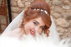 Bride with fashion wedding hairstyle and stylish hair accessory. Beautiful lace wedding dress. Royalty Free Stock Images