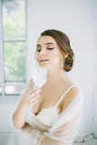 Bride with feathers in hand Stock Photos