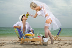 Bride feeding her groom with grapes Royalty Free Stock Photo